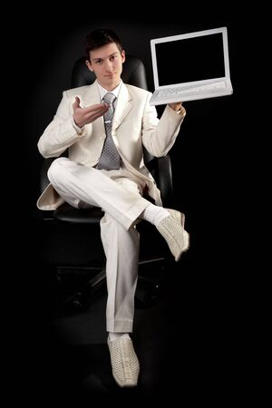 Young man in white with white laptop Stock Photo - 6360899