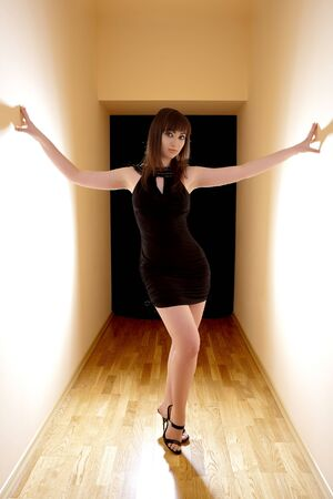 Beautiful sexy woman standing at the corridor photo