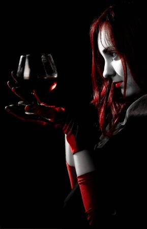 Red haired girl looking to a glass of wine Stock Photo - 6366530