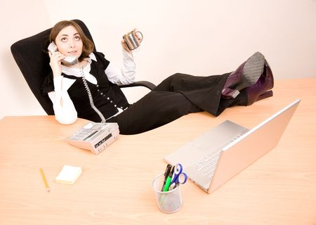 appointee: Young businesswoman talking on phone and drinking coffee phone and drinking coffee
