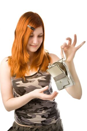 Redhead girl looking to the broken hard drive Stock Photo - 6366570