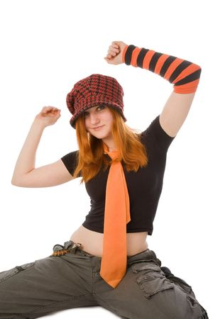 Sitting girl in kit red-black hat and necktie Stock Photo - 6366724