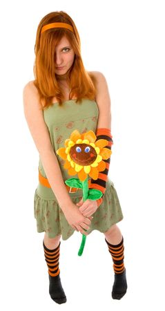Red haired girl holding big smiling flower Stock Photo - 6366690