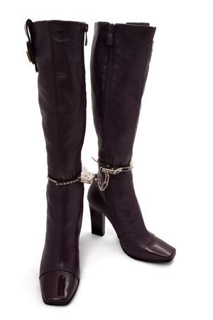 Two boots chained with handcuffs photo
