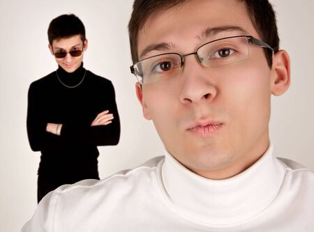 antipode: Two men in white and black clothing Stock Photo