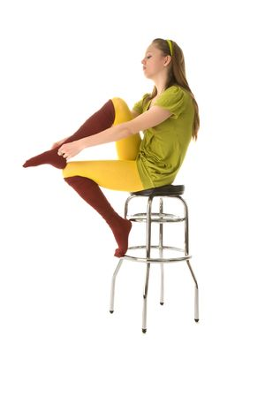 Blond girl sitting on a bar chair Stock Photo - 6400498