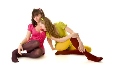 Two funny girls sitting on the floor Stock Photo - 6400441