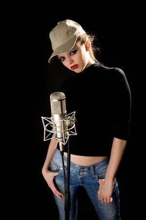 Girl in cap with studio microphone Stock Photo - 6400419