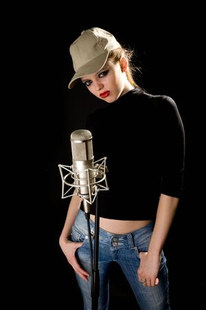 Girl in cap with studio microphone Stock Photo - 6400419
