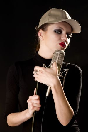Young woman with microphone Stock Photo - 6400481