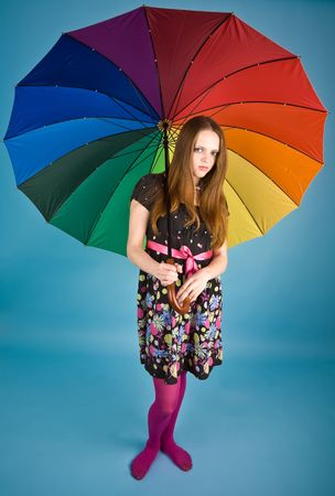 Displeased girl with colorful umbrella Stock Photo - 6400515