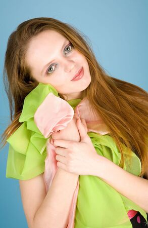 Cute young woman holding colorful tulle Stock Photo - 6400495