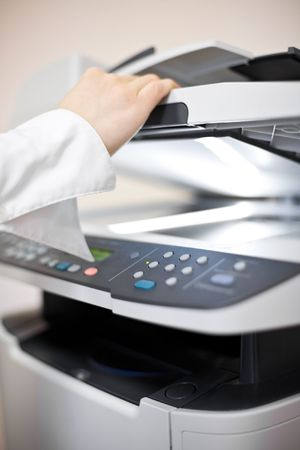 Woman's hand with working copier Stock Photo - 6405148