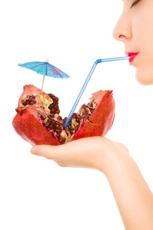 pith: Beautiful woman with pomegranate and straw drinking
