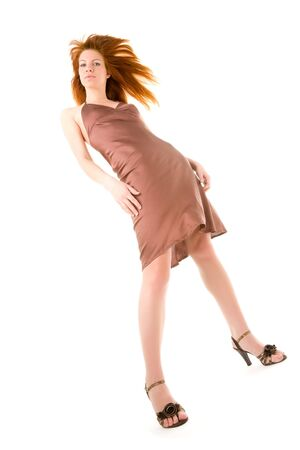 Elegant young redhead woman posing Stock Photo - 6400512