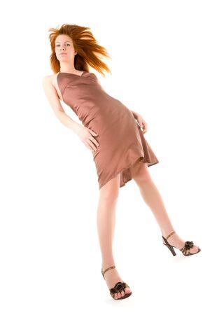 Elegant young redhead woman posing Stock Photo - 6400512
