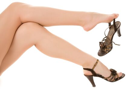Long womans legs with sandals photo