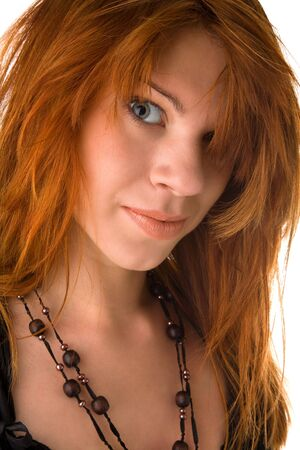 bedhead: Red haired girl with messy hair looking to the camera