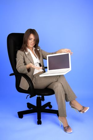 Young woman in costume with laptop Stock Photo - 6400455
