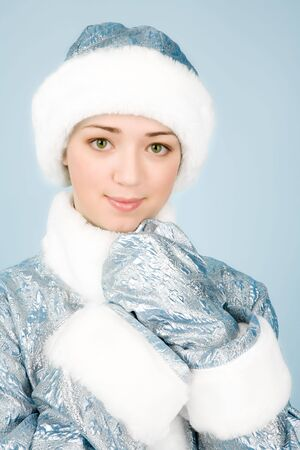 Beautiful girl in Snow Maiden costume photo