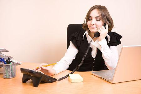 appointee: Beautiful businesswoman talking on phone Stock Photo