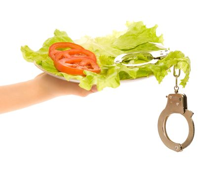 Healthy food and handcuffs on the plate Stock Photo - 6444903