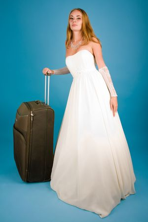 Bride with large suitcase looking to the camera Stock Photo - 6444914