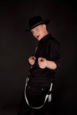 the showman: Young showman in black