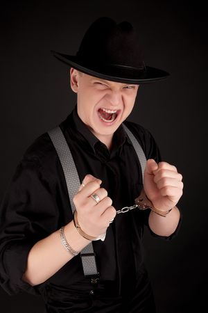 Young man in the handcuffs shouting Stock Photo - 6569165
