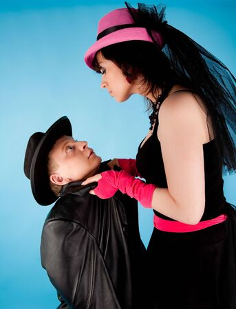 Woman in pink hat and black dress holding the man in black Stock Photo - 6569179