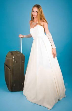 Bride with large suitcase looking to the camera Stock Photo - 6569158