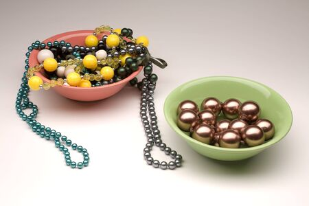 Make the choice between two colorful plates with diffrent beads photo