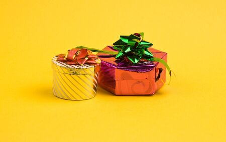 Two gift boxes on yellow background photo