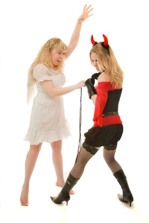 Two girls in angel and demon costumes fighting photo