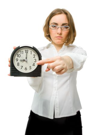 Angry girl points her finger to clock (focus on clock) Stock Photo - 6720172