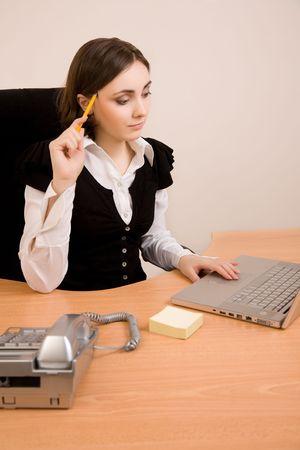 appointee: Young secretary with  telephone, laptop and pencil thinking Stock Photo