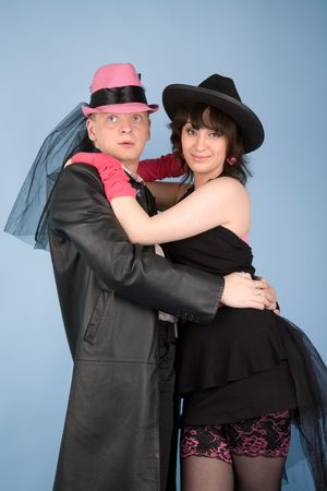 Woman in black hat and dress  and a man in pink hat photo