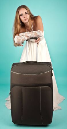 Bride with large suitcase looking to the camera Stock Photo - 6720184