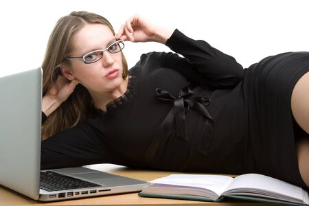 Sexy businesswoman lying on the desk photo