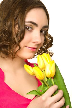 Beautiful woman with yellow tulips photo