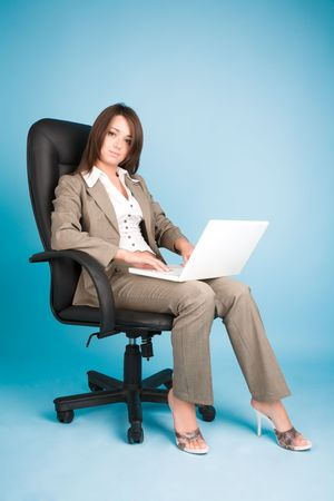 Young woman in costume with laptop Stock Photo - 6720193