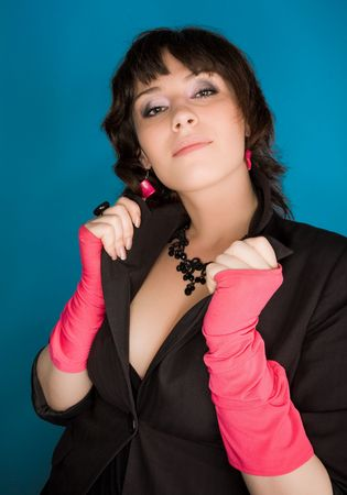 Picture of a young woman in jacket and pink gloves Stock Photo - 6727754