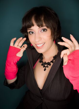 Picture of a young woman in jacket and pink gloves smiling Stock Photo - 6727759