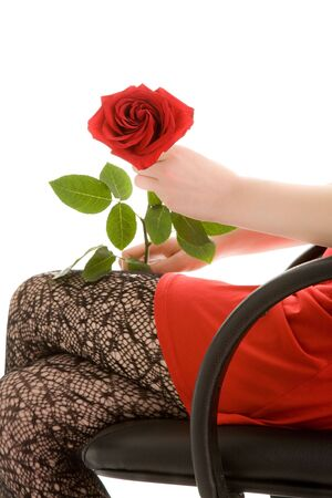 Girl holding a beautiful red rose photo