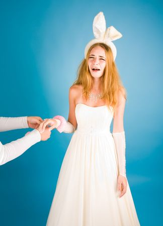 Beautiful girl in wedding dress and rabbit's ears crying Stock Photo - 6727719
