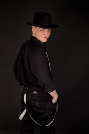 the showman: Young showman in black smiling