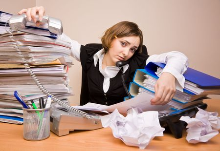 appointee: Young tired businesswoman with tons of documents calling phone