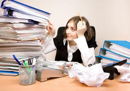 Young secretary with a lot of folders sitting Stock Photo - 6758482