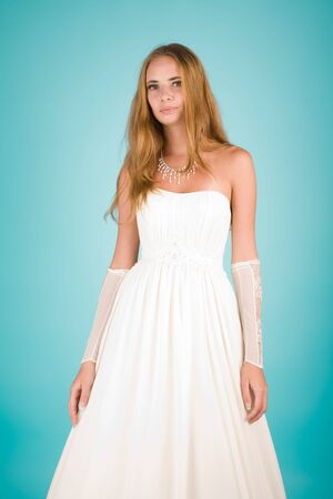 Beautiful girl in wedding dress looking to the camera Stock Photo - 6758419
