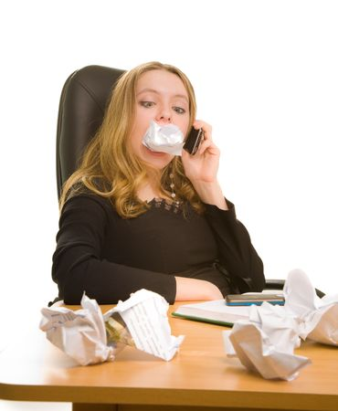 Businesswoman with sheet of paper in her mouth calling to phone Stock Photo - 6758444